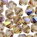 Perles toupie cristal Swarovski 4mm light colorado topaz AB (x50)